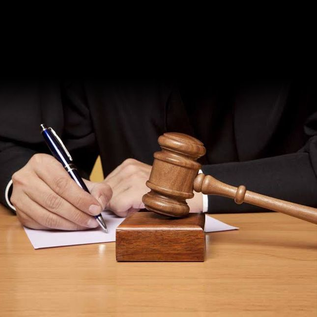 A lawyer filling a fir report on paper